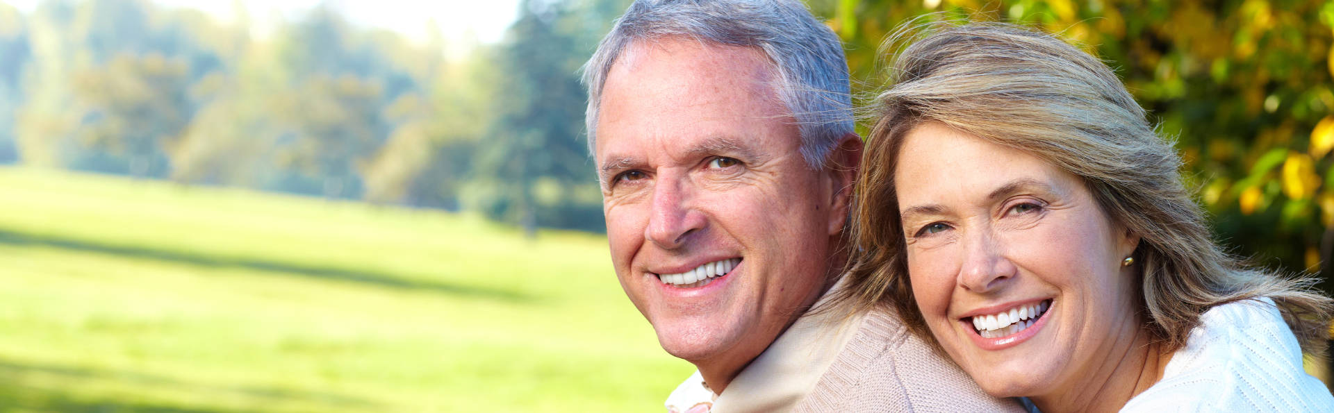 Smiling Elderly Couple After Dental Implants from Jefferson Dental Care GA