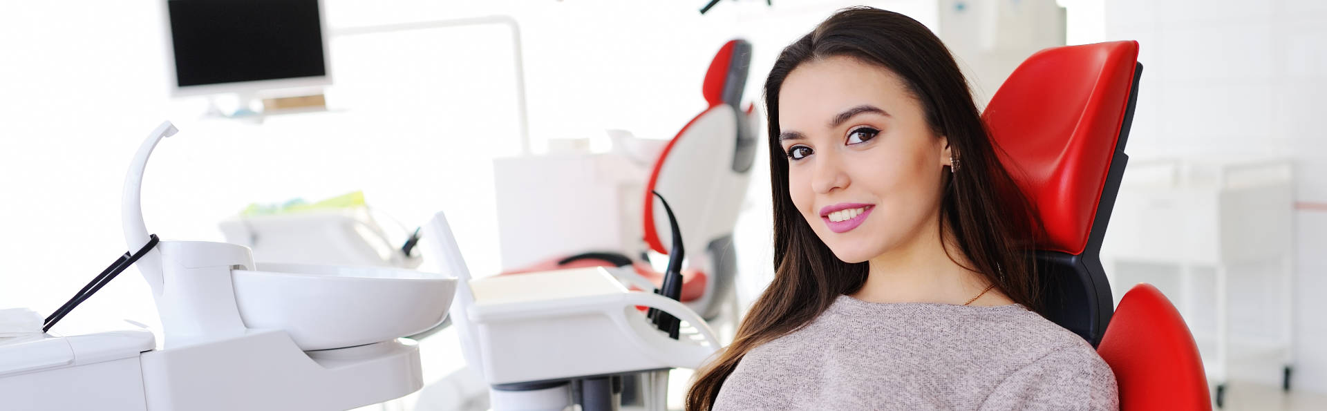woman sitting on a dentistry chair
