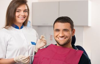 Male Patient Smiling with Female Hygientist