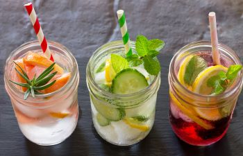 ice water with fruit in glasses with a straw